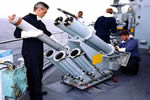 Royal Navy-Loading Chaff Rockets.jpg